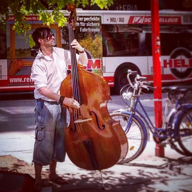 Hamburg-based bassist David Alleckna playing his upright bass in the Hamburg shopping street to promote Wesley Collin George's new single.